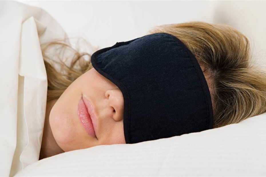 Woman wearing a sleep mask