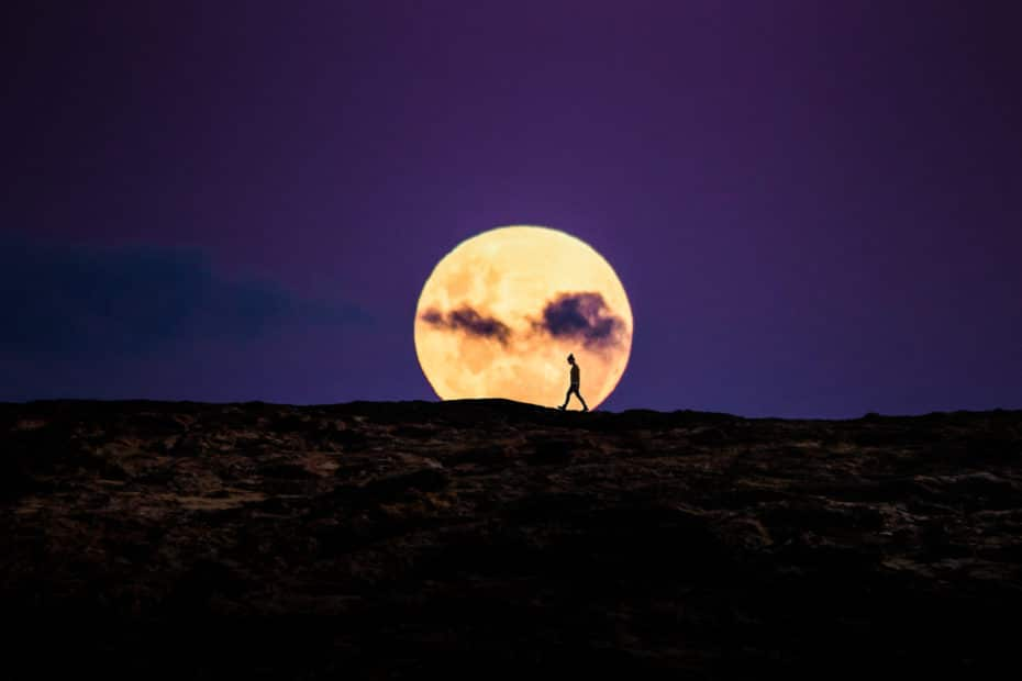 Walking in front of a full moon