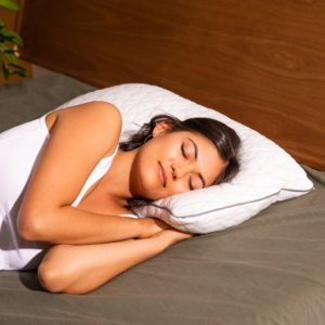 Woman sleeping on Coop Home Goods pillow