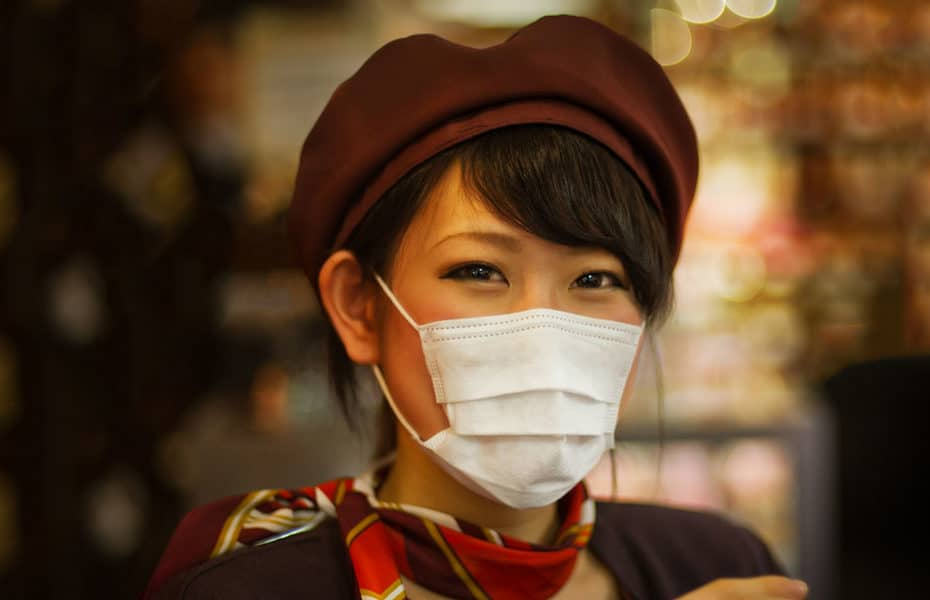 Asian woman wearing a surgical mask