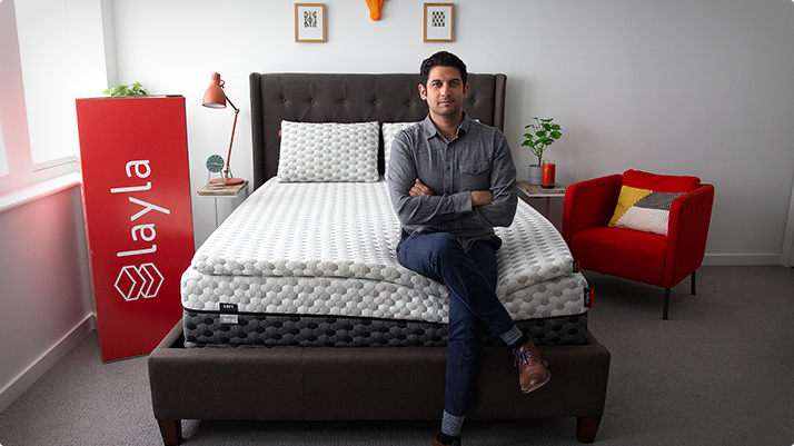 Man sitting on a Layla bed