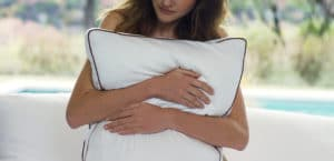 Woman holding a Saatva pillow