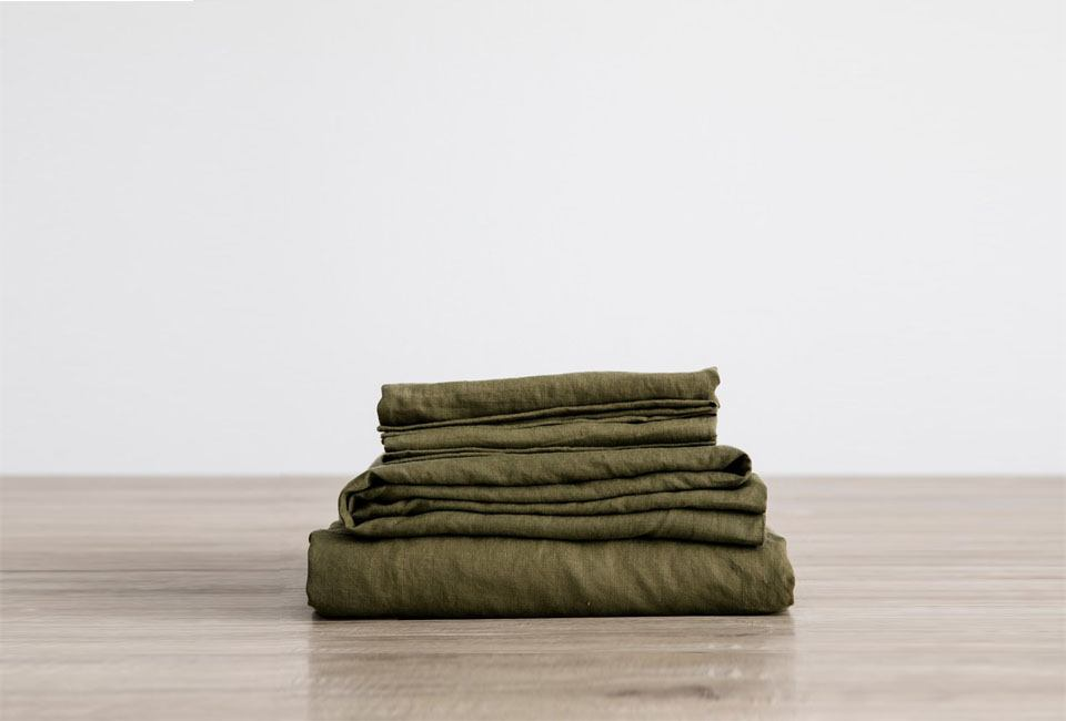 Forest green linen sheets from Cultiver