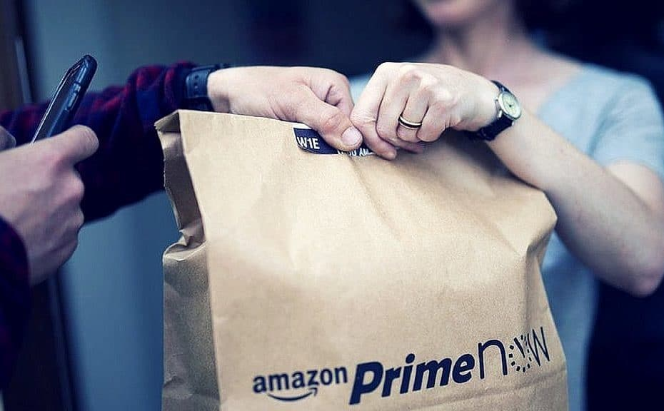 Driver handing Prime Now bag to customer