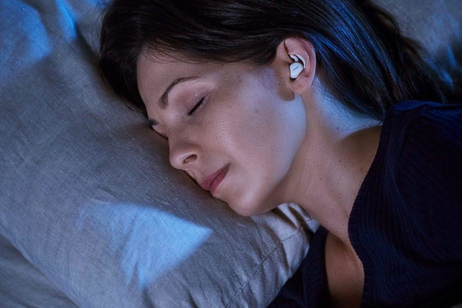 Woman sleeping with Bose Sleepbuds II