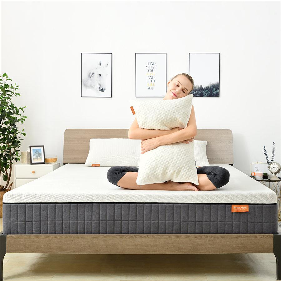 Woman hugging pillow on bed
