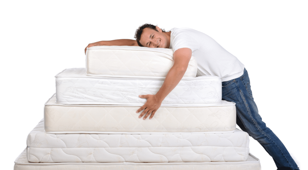 Man with different mattress sizes