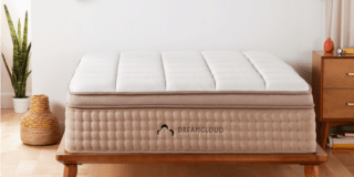 dreamcloud permier on wooden bed