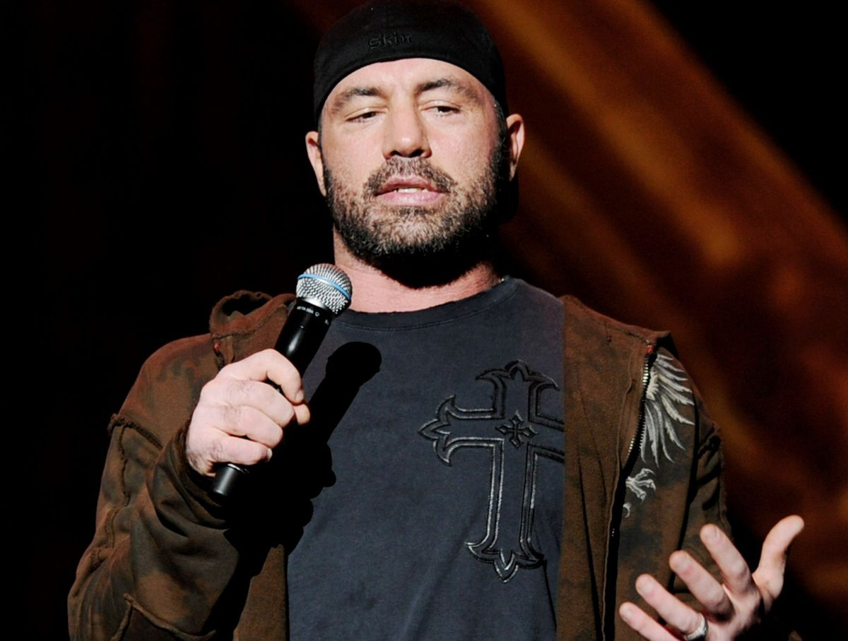 Joe Rogan holding microphone