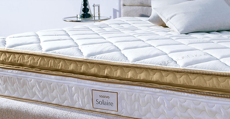 luxury adjustable bed in a white bedroom