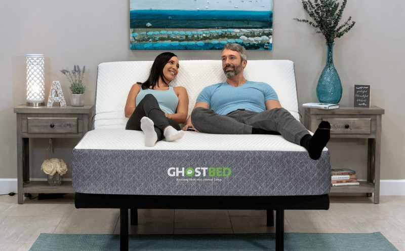 Couple lounging on GhostBed adjustable base in a bright room